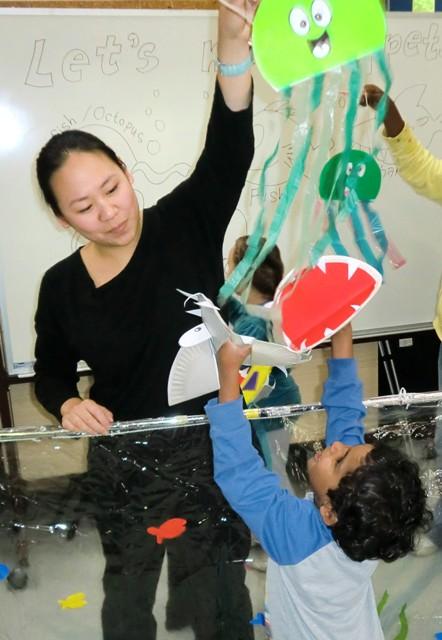 kay-yasugi-and-child-playing-with-jellyfish-puppet.jpg